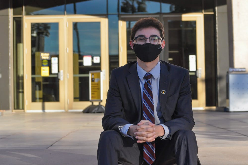 Armando Montero, recently elected governing board member for the Tempe Union School District, poses for a portrait out front of Hayden Library