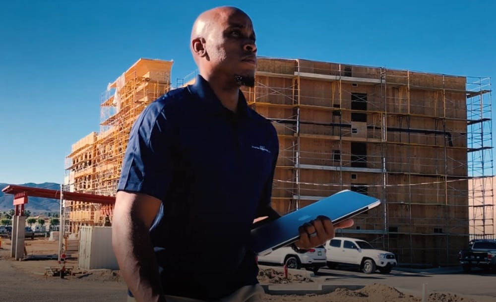 Anthony Winston III poses in front of a construction site in Murrieta, California