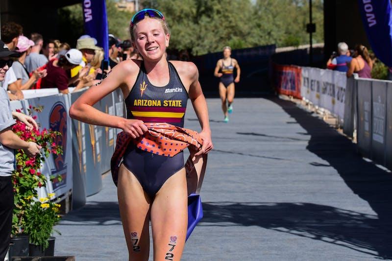 Hannah Henry crosses the finish line of a 2018 triathlon