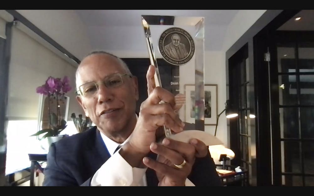 Dean Baquet holds up the Walter Cronkite Award for Excellence in Journalism