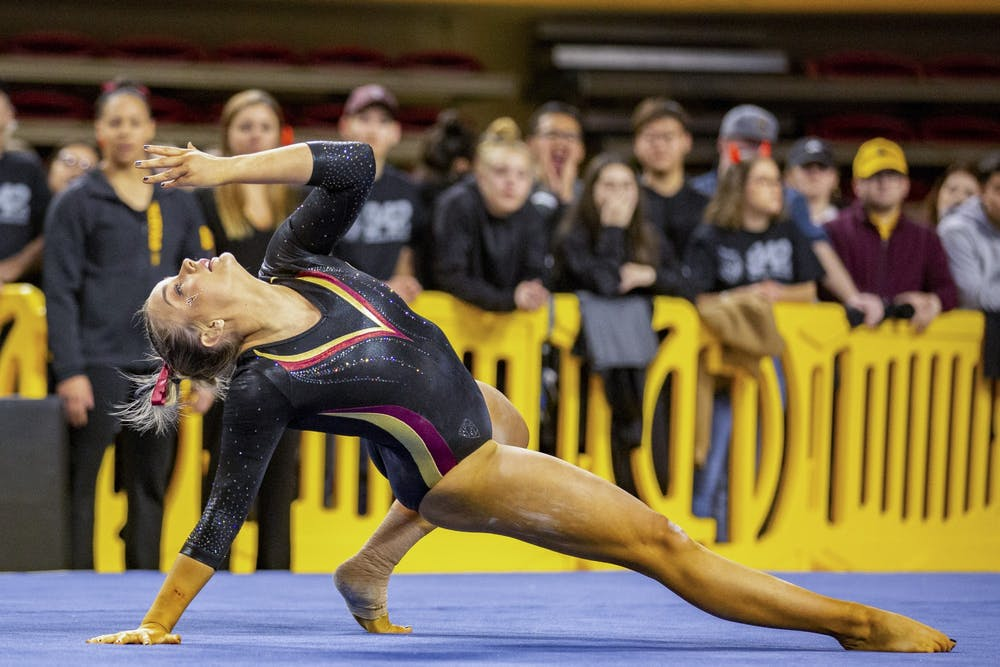 ASU now-sophomore Hannah Scharf competes on the floor during a gymnastics competition against UC Davis.