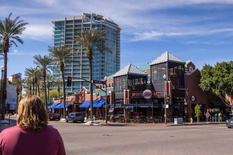 Pedestrians walk near Zipp's Sports Bar and Grill on Mill Avenue in Tempe, Arizona, on Wednesday, Feb. 20, 2019.