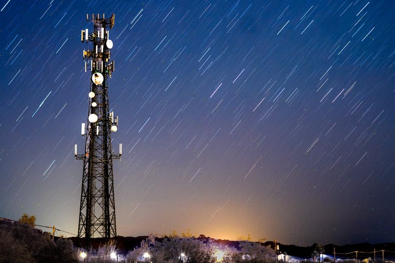A radio tower in Pinal County, Arizona is shown against a starry night sky.