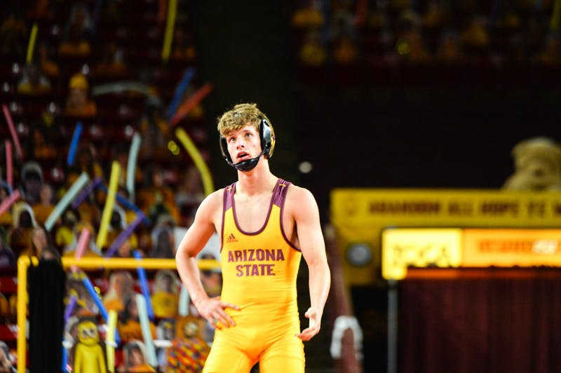 Lou Fincher stands on the mat