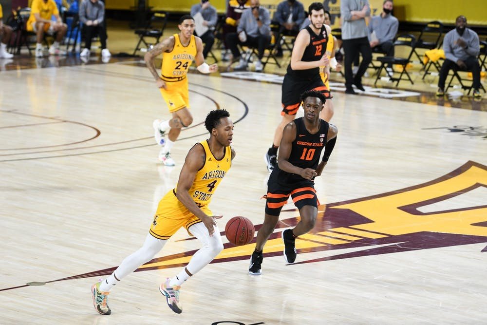 Kimani Lawrence drives the basketball against Oregon State