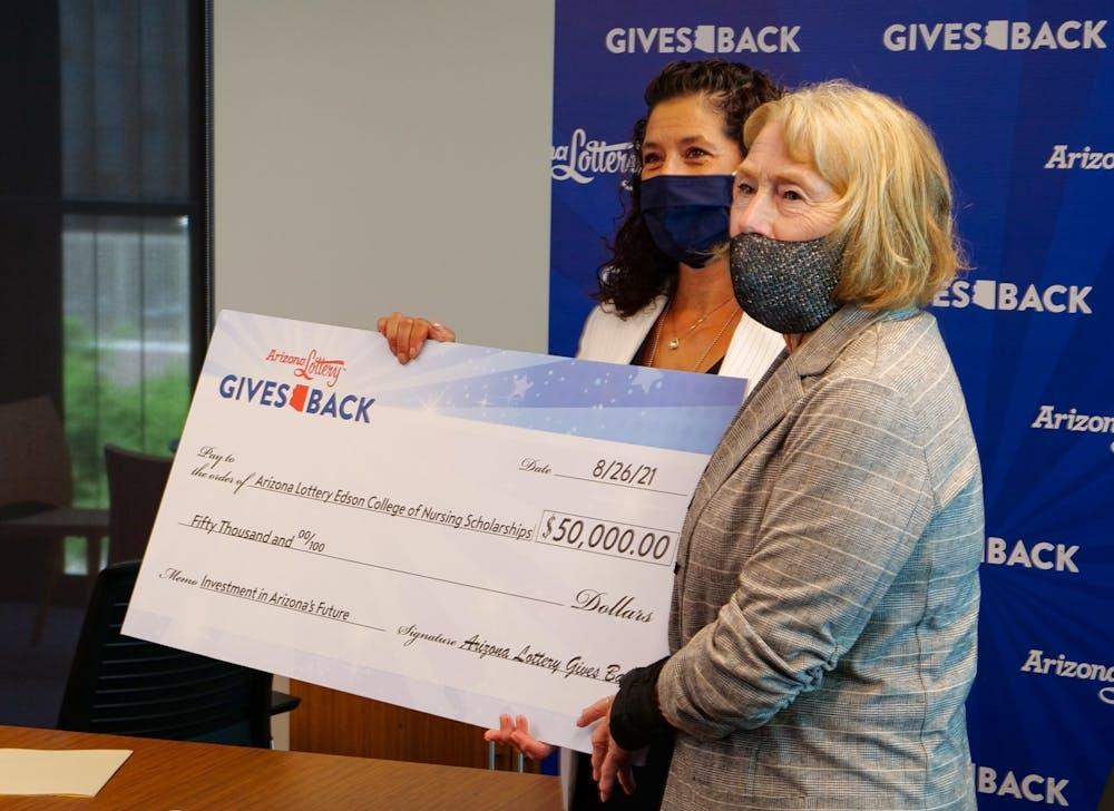 Sherri Zendri and Judith Karshmer hold a check for $50,000