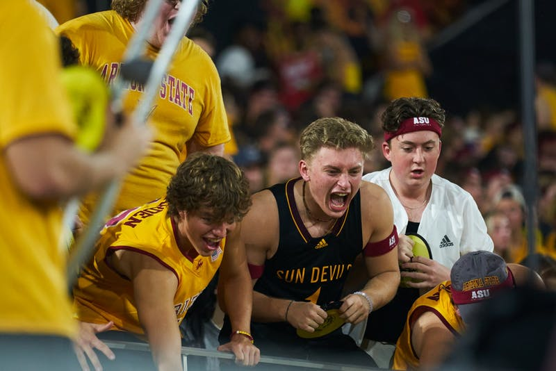 ASU fans cheer after a play