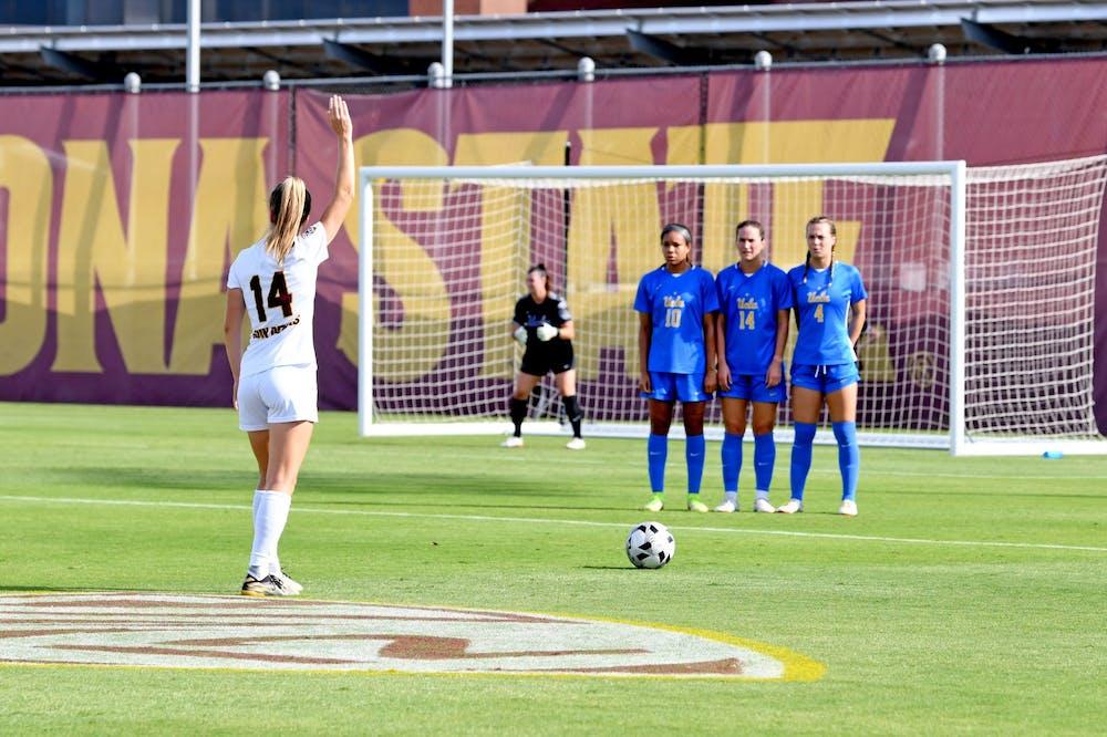 Eva van Deursen (14) takes a free kick against UCLA