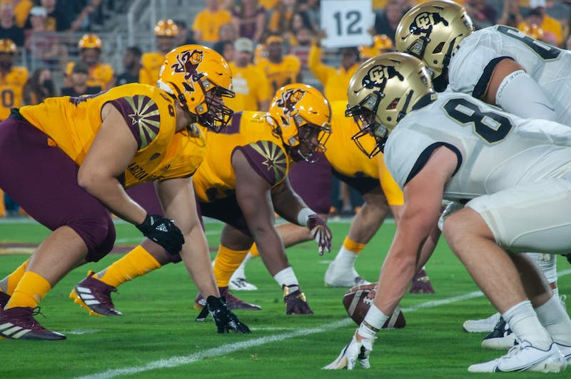ASU and Colorado football teams line up against each other