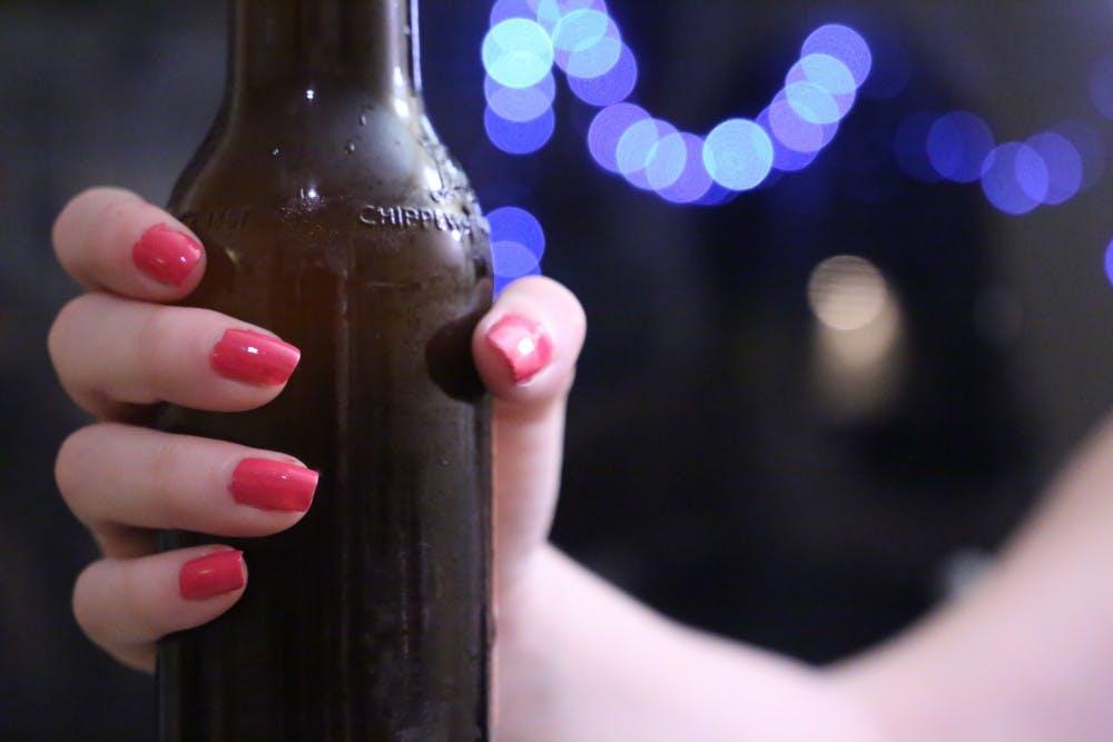 females_hand_on_beer