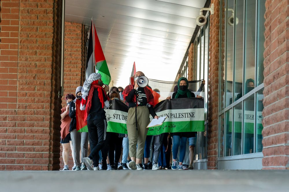 Groups including Students for Justice in Palestine march in-front of the Fulton Center