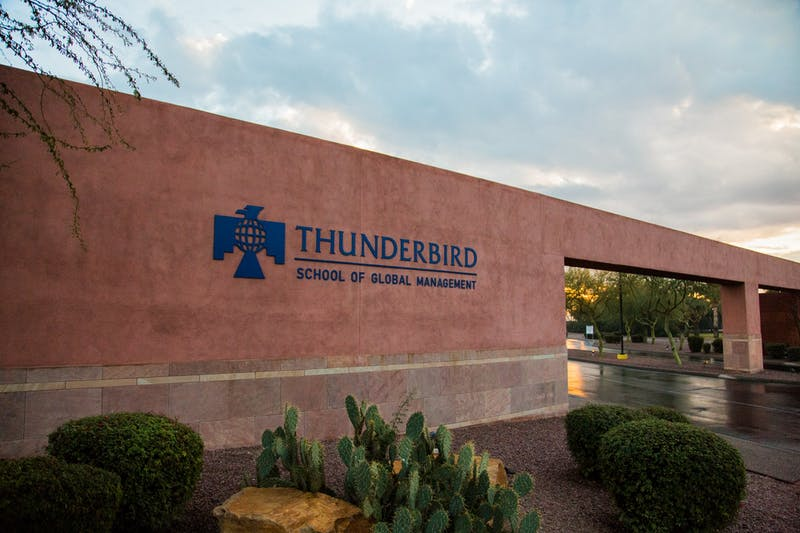 A Thunderbird School of Global Management logo is shown on a wall in Glendale.