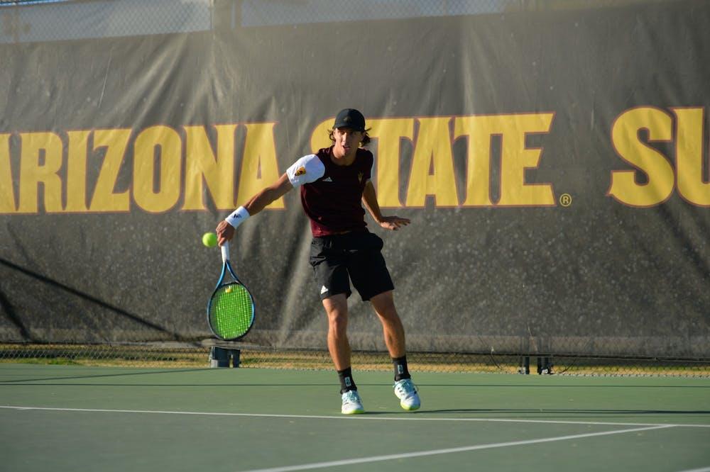 Andrea Bolla hits the ball across the court against Washington