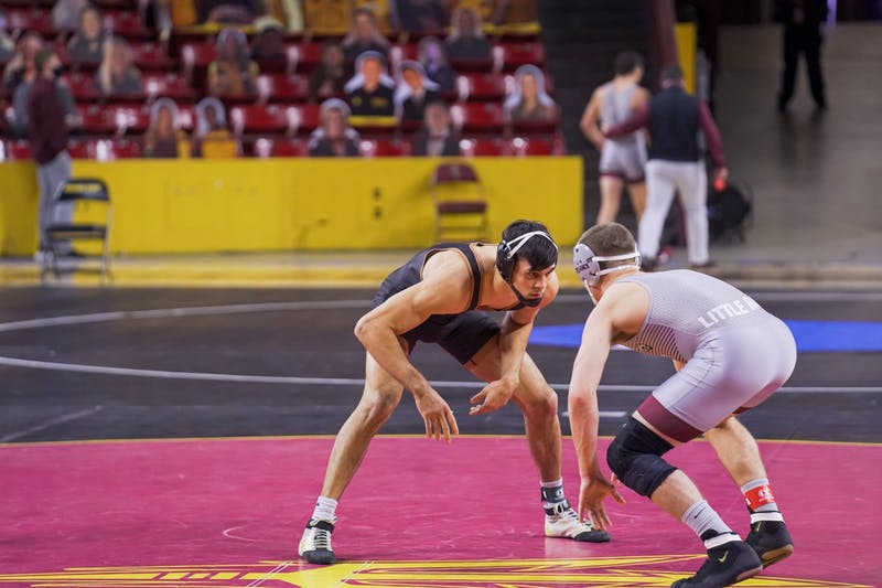 Cade Belshay stares down Little Rock freshman Zane Davis during a wrestling match