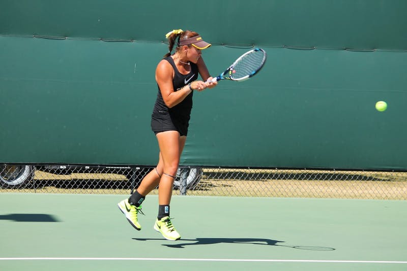 ASU Sophomore Kassidy Jump returns with a backhand during 6-4 6-