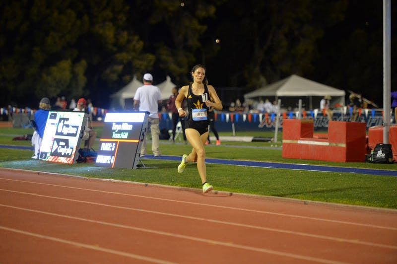 Jane Miller runs in the women's 1,500 meters
