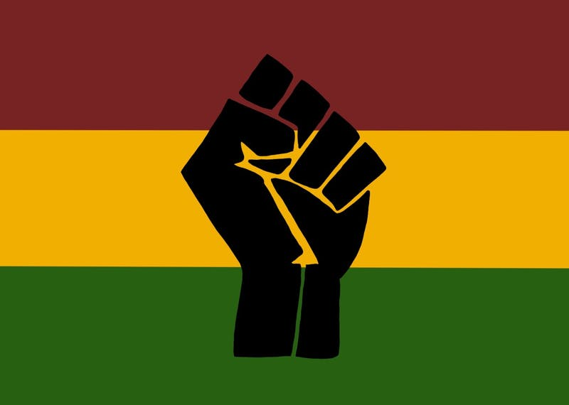 An illustration of a fist with the Black History Month colors behind it.