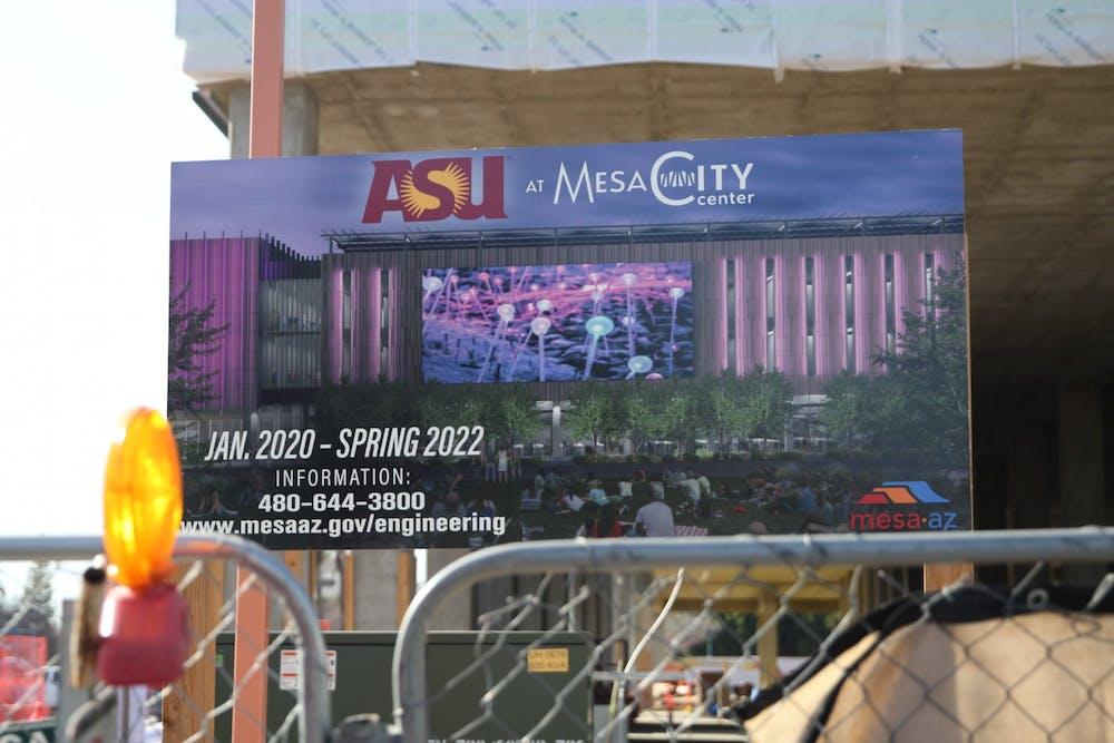 A sign at a construction site depicting the future ASU at Mesa City Center building.