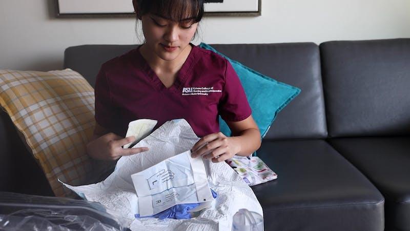 Alyssa Mae Romero showcases her nursing supplies on Sept. 23, 2020.