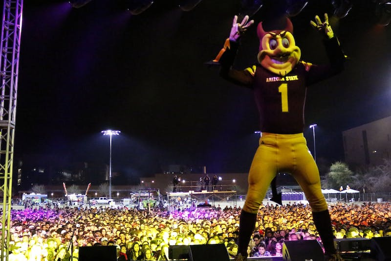 ASU's mascot Sparky poses on stage before hip-hop duo Rae Sremmurd performs at ASU's Devilpalooza in Tempe on Saturday, Feb. 25, 2016. Attendance at the 2021 DevilPalooza will limited due to COVID-19.