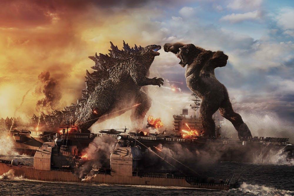 Godzilla and King Kong fight atop an aircraft carrier