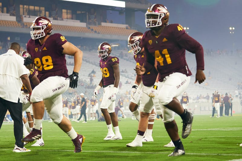 ASU players running off the field during warm up.