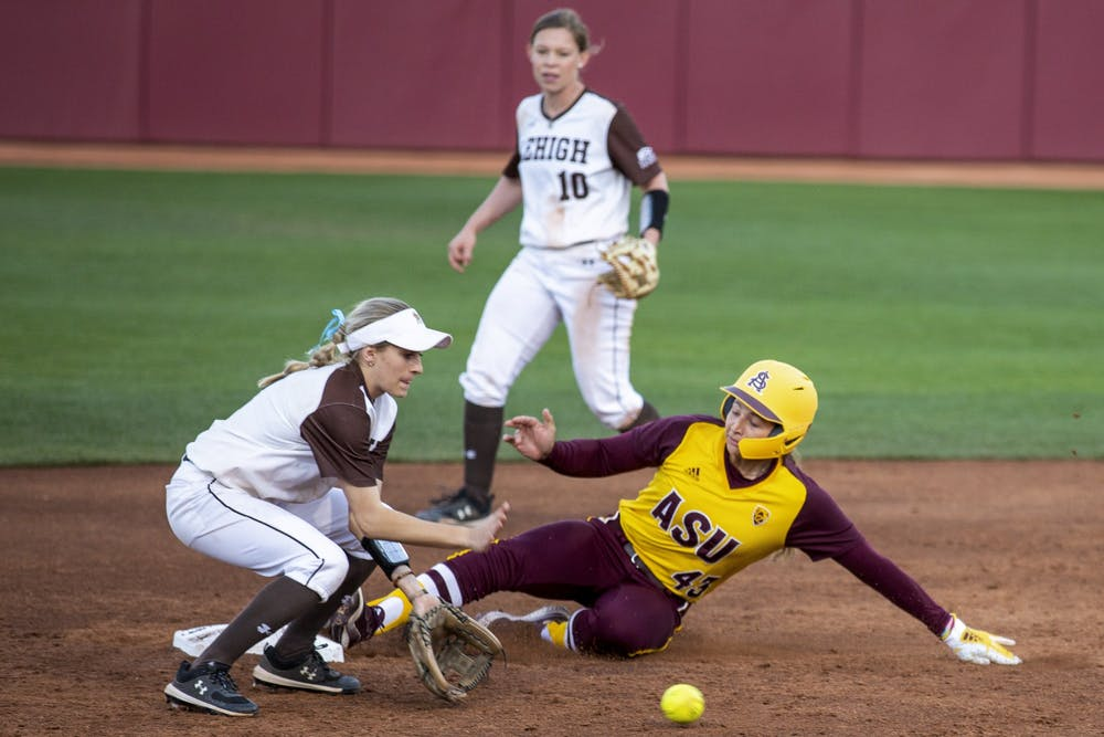 Mailey McLemore (43) slides into second base