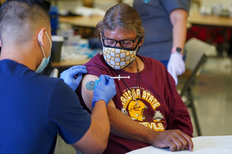 A person receiving the Johnson and Johnson vaccine in their arm, in an effort to vaccinate the homelessness population in Phoenix.