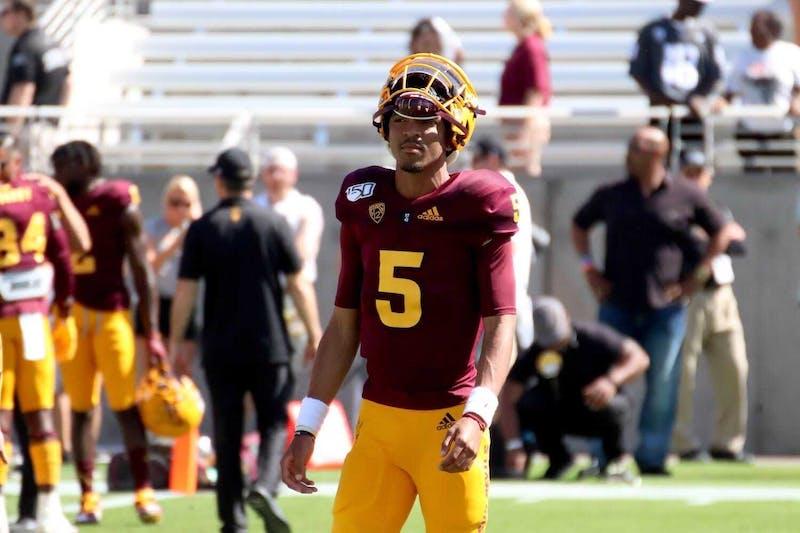 ASU quarterback Jayden Daniels (5) walks the field.