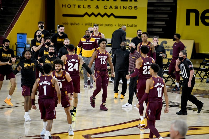 The ASU men's basketball team comes together for a timeout.