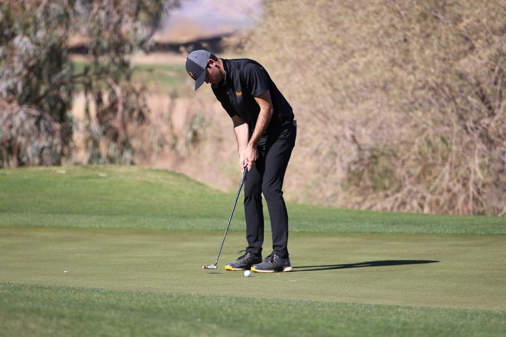 ASU junior golfer Cameron Sisk puts the ball during the Cooper Cup