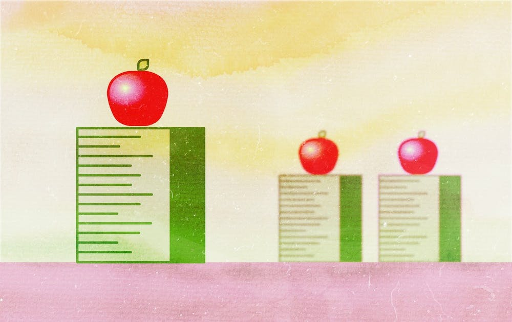 An illustration of apples raised up on rulers.