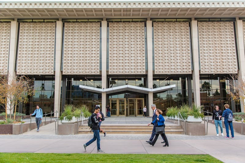 ASU students walk past the newly redesigned Hayden Library on the Tempe campus on Thursday, Jan. 16, 2020.