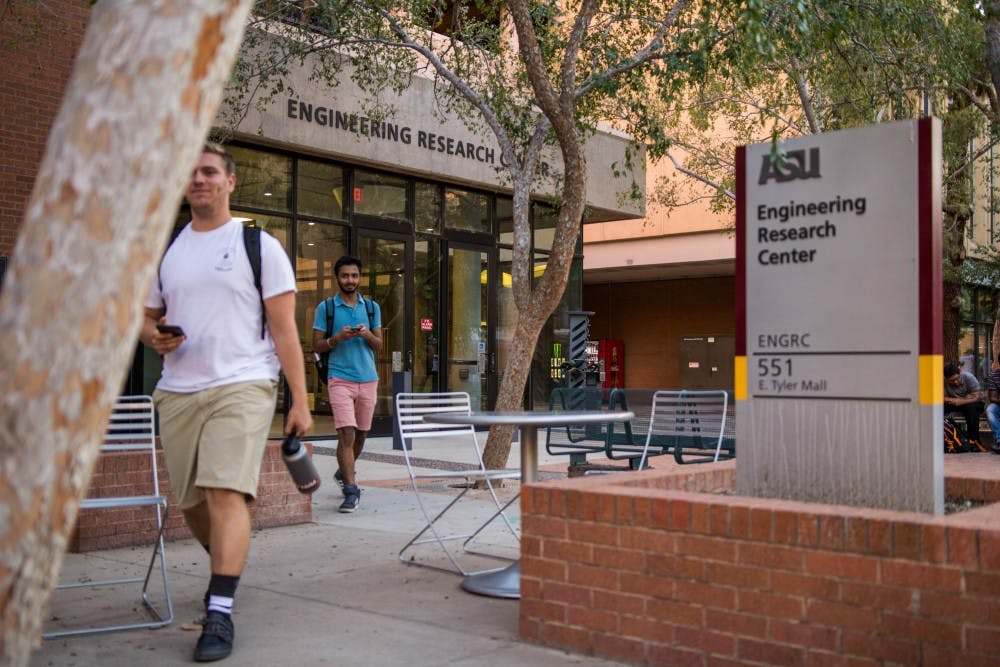 ASU students walk out of the Ira A. Fulton School of Engineering Research Building