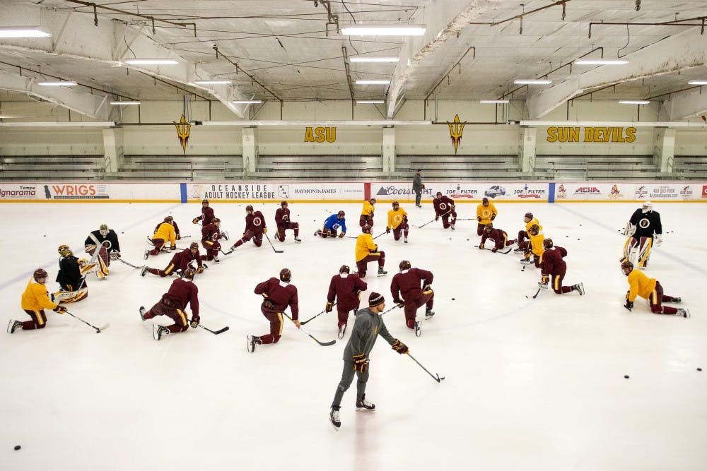 The ASU Ice Hockey team skating on a rink.