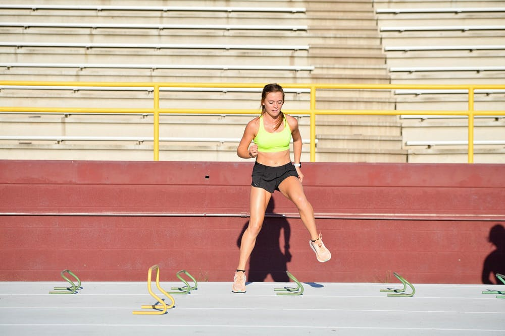 ASU student jumping over equipment horizontally while training.