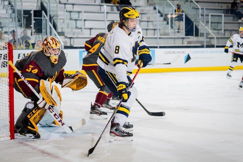 Cole Brady guards the net against Michigan