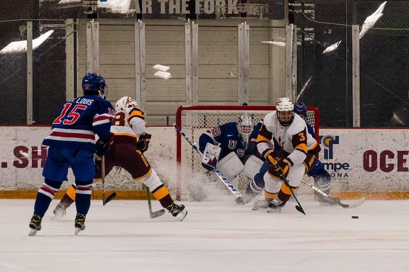 Gvido Jansons (3) skates with the puck