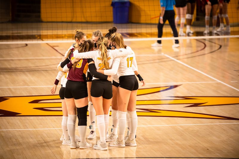 The ASU Volleyball team huddled together