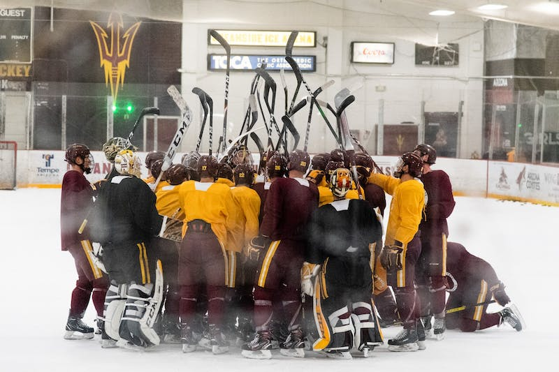 The ASU hockey team huddles up during practice on Tuesday, Oct. 29, 2019, at Oceanside Ice Arena in Tempe.