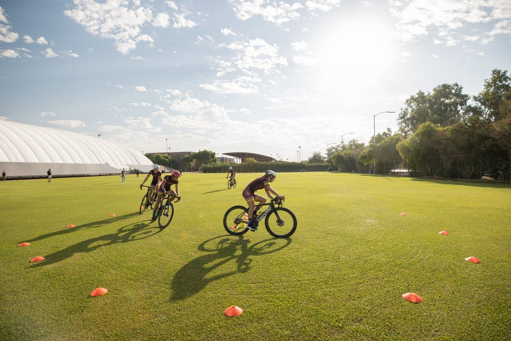 Riders of the ASU triathlon team take corner three during the bike skills obstacle course