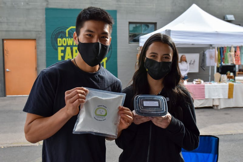 Brendan Wong and Angelica Olivas poses for a photo holding Mochi.