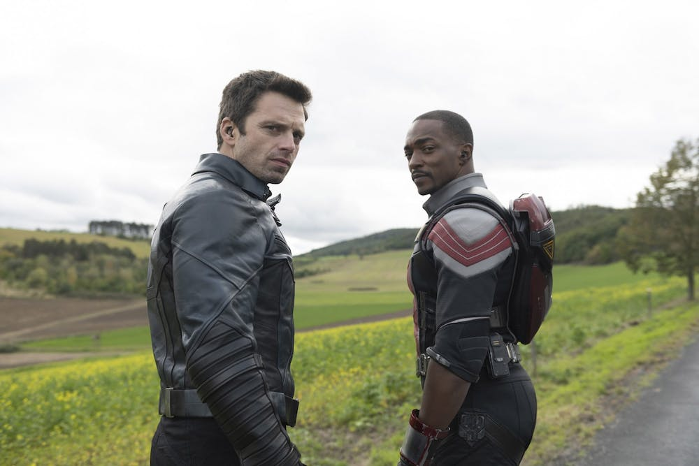 Sebastian Stan and Anthony Mackie look toward the camerain a scene from Marvel's The Falcon and Winter Solider.