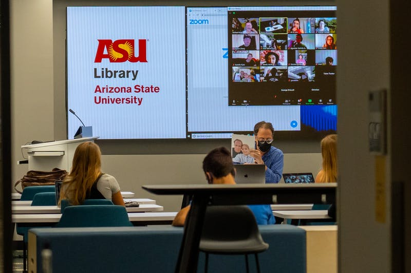 A professor introduces their family to their class on the first day of class on Thursday, Aug. 20, 2020, on the ASU Tempe campus.
