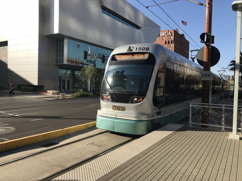 The light rail approaches the Van Buren and 1st Ave light rail stop