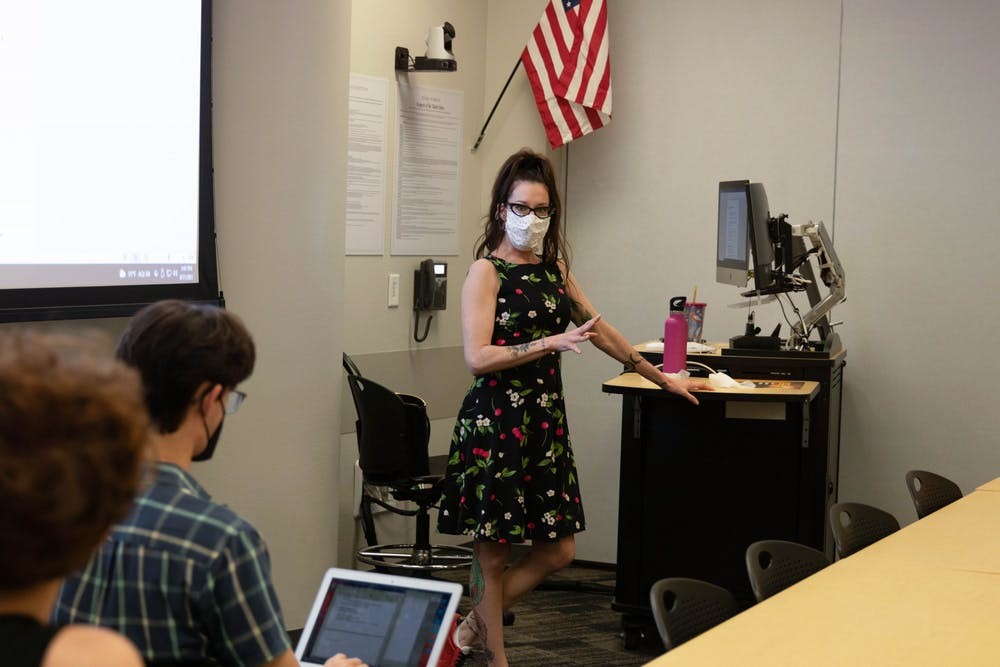 Professor Rosemarie Dombrowski lectures a classroom of students.