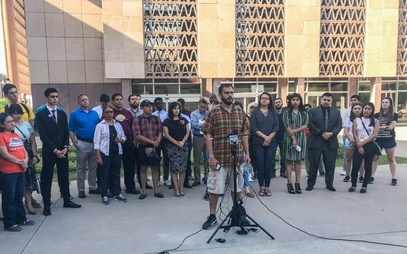 ASU journalism senior and DACA recipient Edder Diaz Martinez speaks at a press conference in front of the capitol building in Phoenix, Arizona, on Monday, April 9, 2018.