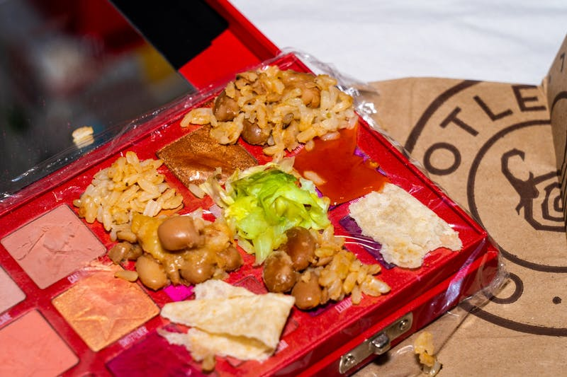 A makeup palette with burrito fixings on it is shown.