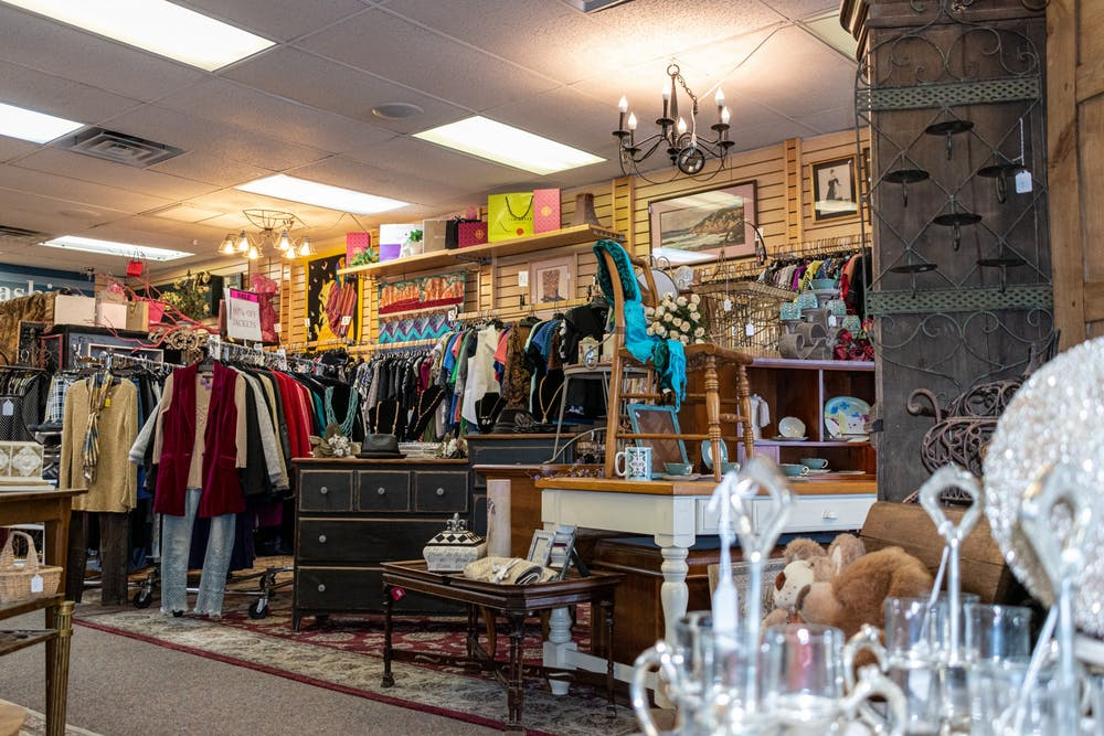Items for sale inside of Rescued Treasures Charity Thrift Boutique are shown.