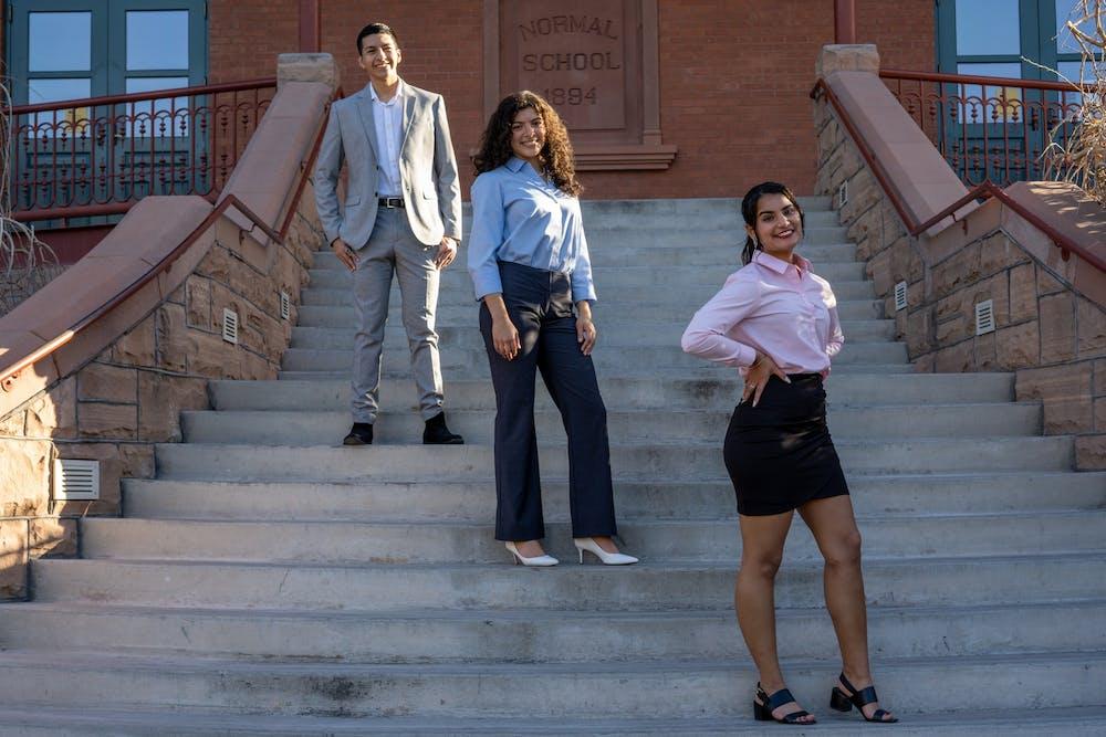 Christopher Hernandez, Valeria Perez, Jasmine Lopez pose on the steps of Old Main.